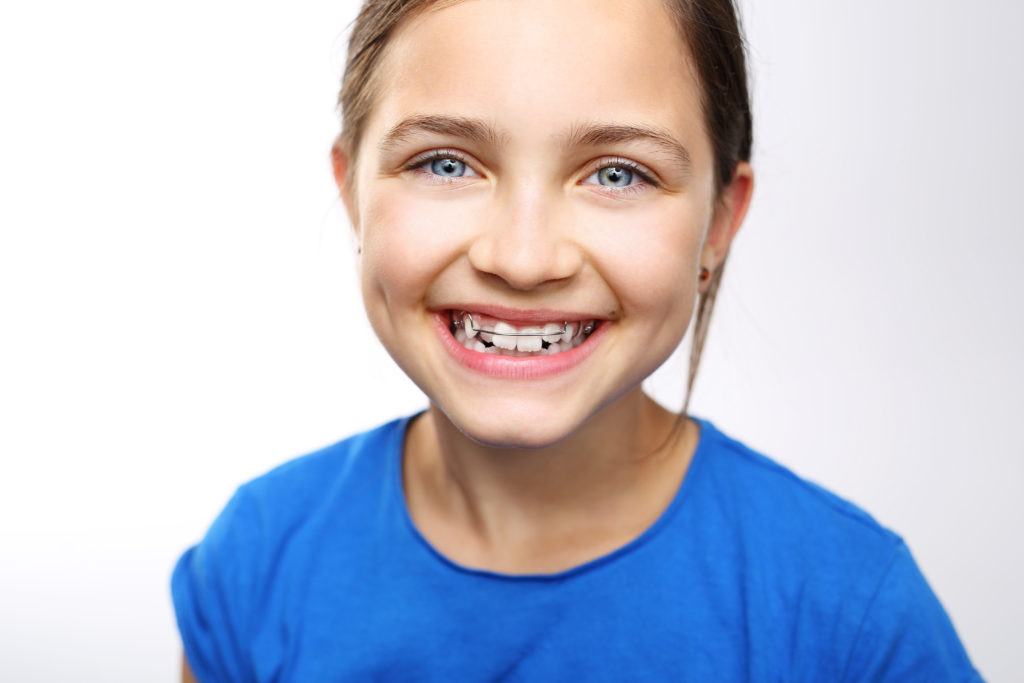 Young girl smiling with retainer