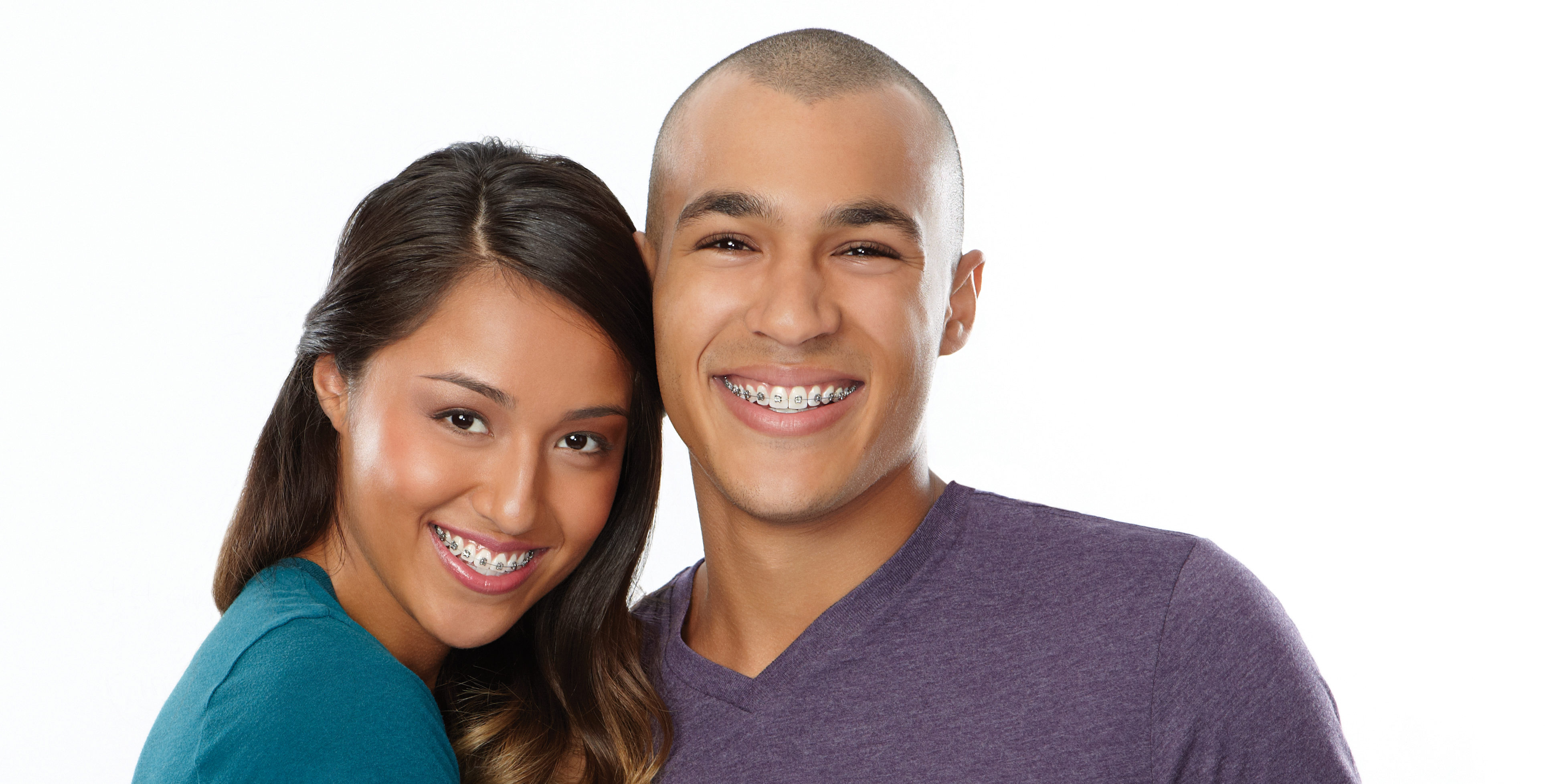 Young couple wearing braces smiling