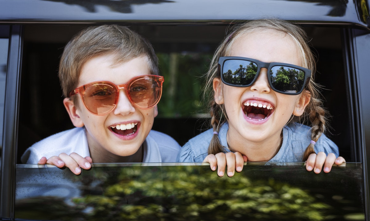 Photo of two kids with sunglasses